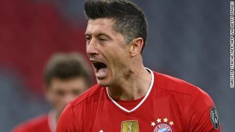 Robert Lewandowski celebrates scoring the opening goal from the penalty spot.