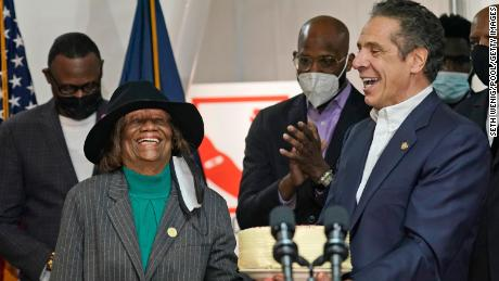 Cuomo presents Hazel Dukes, president of the New York State chapter of the NAACP, with a cake to celebrate her birthday.