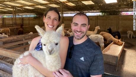 Aliza and Dan visiting alpacas in Chile in 2019.