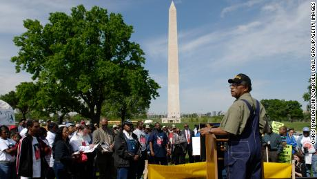 "Leavenworth, Kansas, farmer George Hildebrandt speaks at a rally ""for justice in the Agriculture Department's farm system"" on the Mall outside the USDA on April 26, 2006, in Washington, DC."