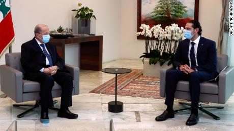 President Michel Aoun (L) meets with Prime Minister-Designate Saad Hariri at the presidential palace on March 18.