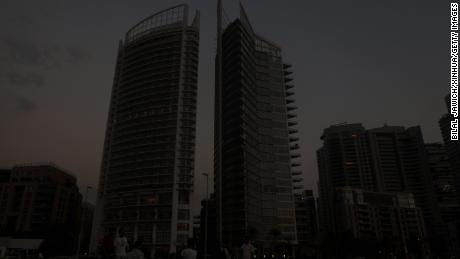 Buildings loom in darkness during a blackout in Beirut on July 5, 2020.