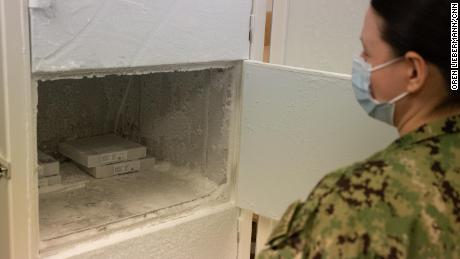Lt. Jennifer M. White opens the freezer used to store the Pfizer vaccine at Naval Medical Center Portsmouth on March 15th.