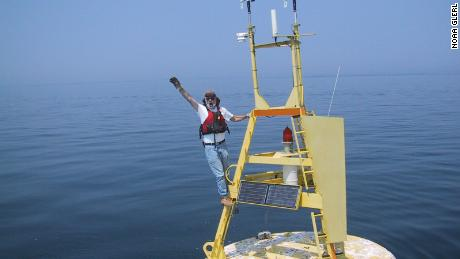 Mike McCormick, a co-author on the new study, stands on a buoy in Lake Michigan in 1999.