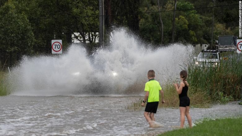 Entire house floats away as flash floods batter Australia's east coast