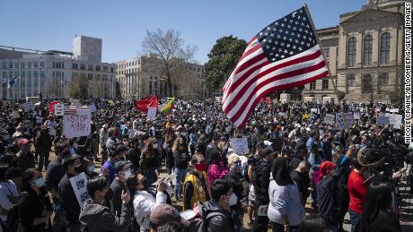Demonstrators gather at Liberty Plaza during an anti-Asian hate rally outside the Georgia Capitol in Atlanta on Saturday, March 20.