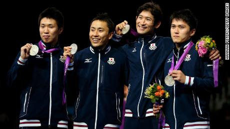 Miyake celebrates with his team after winning a silver medal at London 2012.