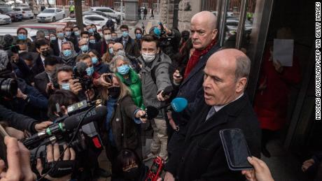 William Klein (behind R), the acting deputy chief of mission at the US Embassy in Beijing, and Jim Nickel (front R), the charge d'affaires of the Canadian embassy in Beijing, speak to the media outside the Beijing Second Intermediate People's Court in Beijing on March 22, 2021, after being refused access to try and attend the trial for Michael Kovrig, a Canadian detained more than two years ago in China on espionage charges. (Photo by NICOLAS ASFOURI / AFP) (Photo by NICOLAS ASFOURI/AFP via Getty Images)