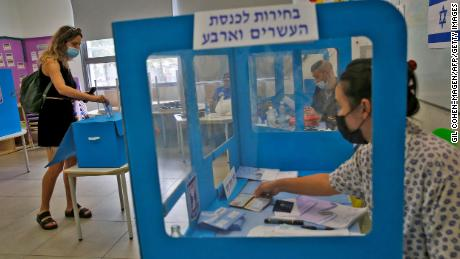 An Israeli voter casts her ballot at a polling station in Tel Aviv on Tuesday.