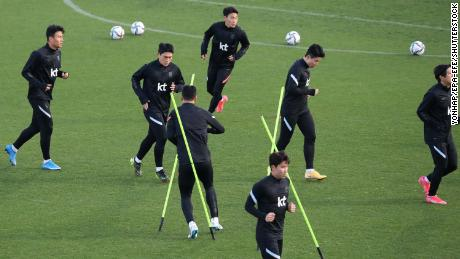 South Korean national soccer team players take part in a training session in Yokohama.