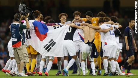 Korea players celebrate after defeating Japan during the men's bronze medal play-off match between Korea and Japan at the London 2012 Olympics.