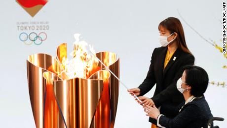 Osaka takes Olympic torch relay off public roads declaring a state of emergency amid rise in Covid-19