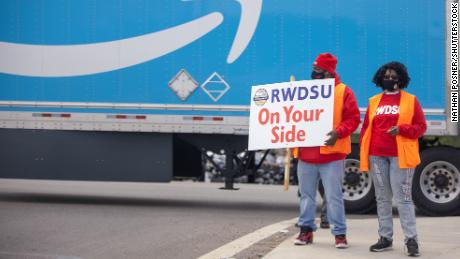 Union organizers are seen outside of the Amazon BHM1 facility in early March.