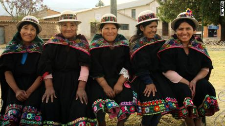 """Andean women are shown in traditional dress in a scene from """"Magical Andes: Season 2"""" on Netflix."""
