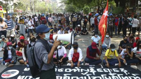Protesters occupy a street during a rally against the military coup on Saturday in Tarmwe township in Yangon, Myanmar.