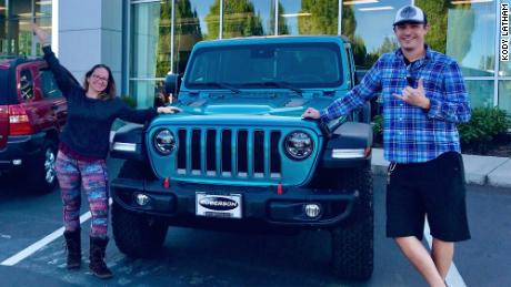 Turo renter Ryan Costello of Hawaii, and Tabitha Stoner, his fiance, with one of the 10 Jeeps that he now rents out.