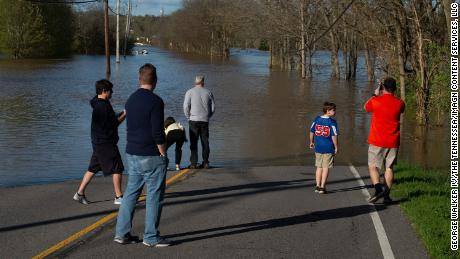 Bellevue residents survey flooding from the Harpeth River Sunday.