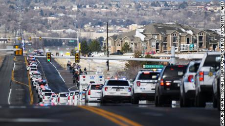 Police vehicles head to Flatirons Community Church for service of Boulder Officer Eric Talley.