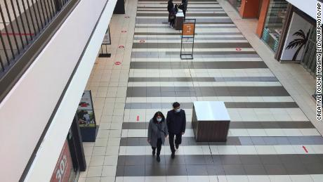 At a shopping mall in Toronto Ontario people wear masks as they shop on March 17