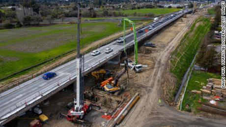 Contractors work on a portion of Highway 101 in Petaluma, California, on March 22. Improving roads and bridges is a key part of Biden's infrastructure plan.
