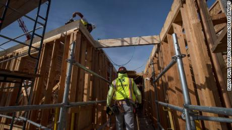 A construction worker walks through an affordable housing project in Oakland, California, in 2019. Biden's plan would invest in affordable housing.