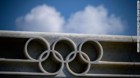 A picture taken on March 8, 2021 in Lausanne shows the Olympic rings next to the headquarters of the IOC.