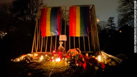 Candles and rainbow flags in the park where David P.'s body was found