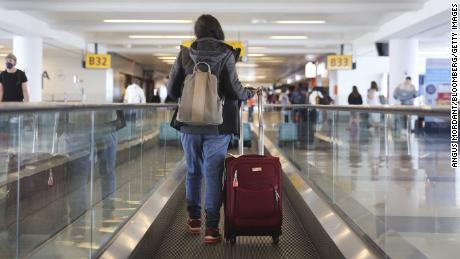 Fully vaccinated people can travel at low risk to themselves, new CDC guidance says