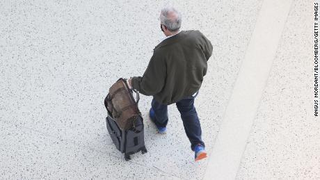 A traveler walks through Terminal 5 at John F. Kennedy International Airport (JFK) in New York.