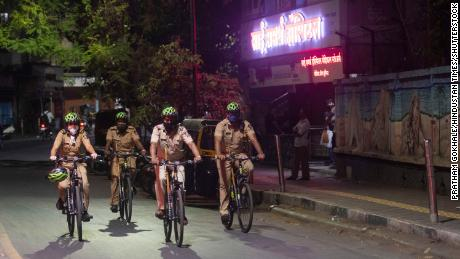 Police personnel patrol Pune, India, on April 3, as new evening curfews go into effect.
