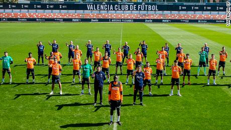 Valencia's squad stands in solidarity at training on Monday.