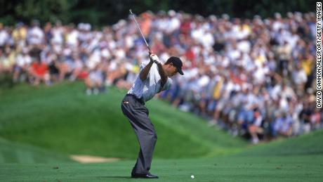 Woods begins to swing during the PGA Championship.