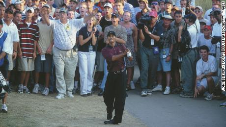 Woods takes his second shot on the 18th on the third hole of the PGA Championship playoffs.