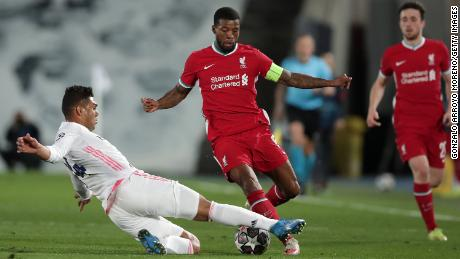 Georginio Wijnaldum is challenged by Casemiro.