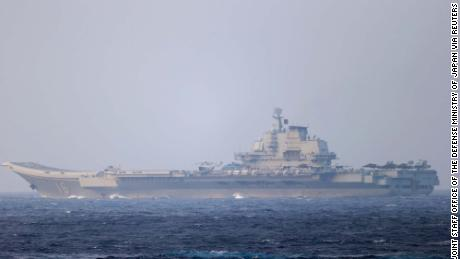 Chinese aircraft carrier Liaoning sails through the Miyako Strait near Okinawa in this photo released by Japan's Defense Ministry on April 4, 2021.