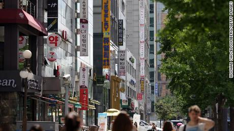 Signs for plastic surgery clinics are displayed on the side of a building in the Sinsa-dong area of Gangnam district in Seoul, South Korea, on August 3, 2013.