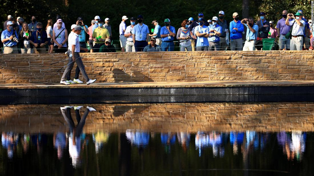 Rory McIlroy and Justin Thomas walk across the Sarazen Bridge during a practice round on Tuesday.