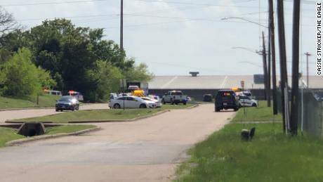 Law enforcement responds to a reported shooting at a business in Bryan, Texas, on Thursday, April 8.
