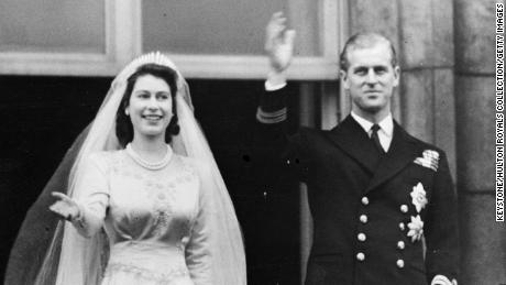 Princess Elizabeth and Prince Philip wave to the crowd from a balcony of Buckingham Palace shortly after their wedding at London's Westminster Abbey in 1947.