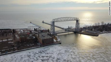 Lake Superior contains roughly 10 percent of world's accessible drinking water and is the largest of the Great Lakes. The Aerial Lift Bridge raises for ships entering the harbor from Lake Superior.
