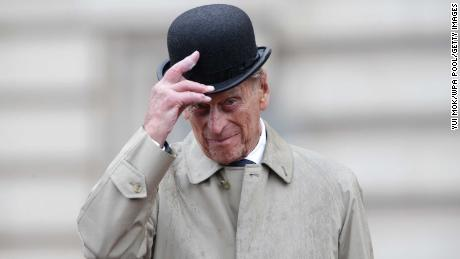 Prince Philip raises his hat in his role as Captain General Royal Marines, as he attends a parade on the Buckingham Palace forecourt in August 2017.