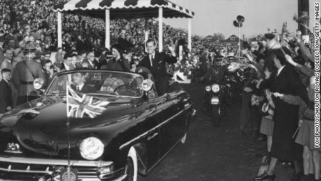 Princess Elizabeth and the Duke of Edinburgh greet a crowd during their tour of Hamilton, Canada in 1951.