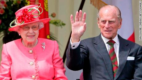 Queen Elizabeth and Prince Philip watch a Diamond Jubilee Pageant during a visit to RAF Cosford in Wolverhampton, England, as part of the Queen's Jubilee Tour of the UK, in July 2012.