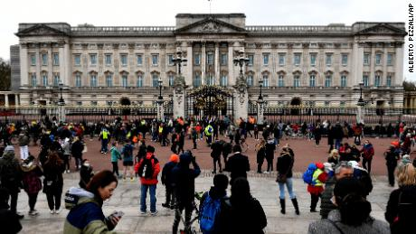 On Saturday, people gather at the gates of Buckingham Palace in London.