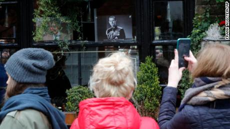 On Saturday, people took cellphone photos of a portrait of Prince Philip in a pub window near Windsor Castle.