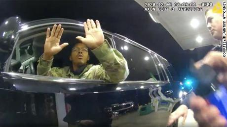 Caron Nazario is seen in this still image from body camera footage holding his hands up before a police officer pepper sprays him.