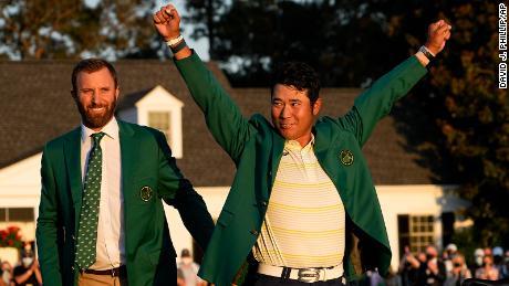 Matsuyama puts on the champion's green jacket after winning the Masters.