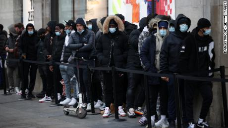 People lined up outside Nike Town on London's Oxford Street on Monday.