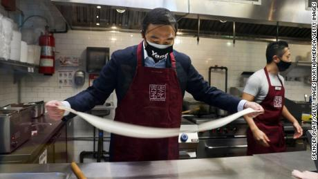 Yang hand pulls noodles as he visits Xi'an Famous Foods in Chinatown on March 5, 2021 in New York City. Yang went behind the counter with owner Jason Wang to hand pull noodles at the restaurant and to hear from workers and others about recent acts of discrimination against the Asian community.