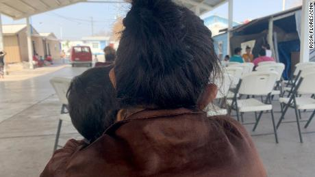 A 31-year-old migrant mom from El Salvador hugs her youngest son as they seek refuge at a shelter in Reynosa, Mexico. Weeks ago, she watched in anguish as her older sons crossed the border alone.